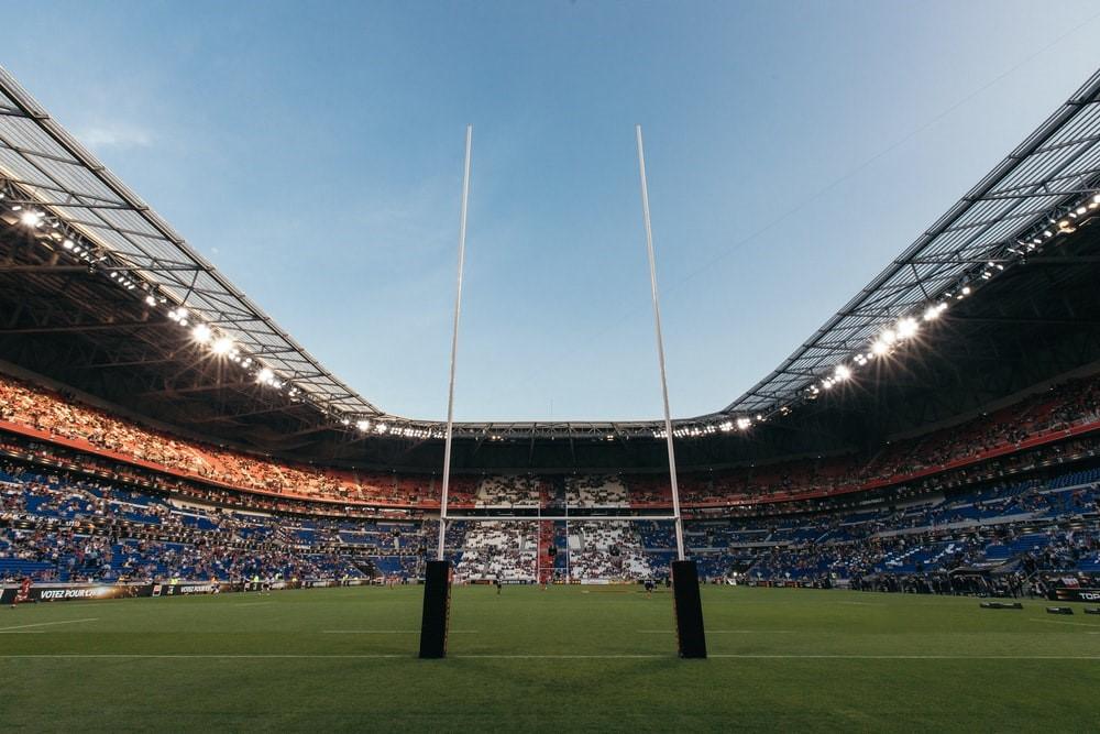 football stadium with spectators betting on the sidelines
