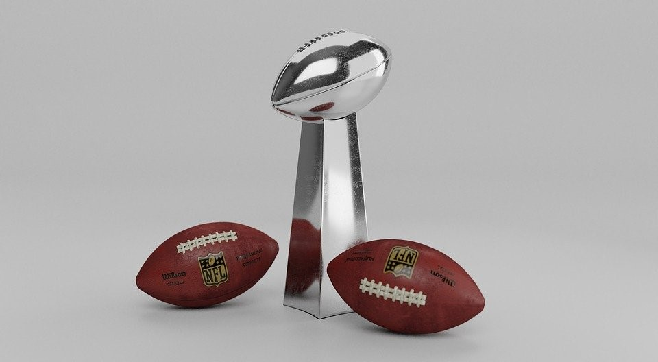 a trophy with a pair of footballs