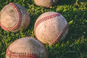 baseballs on grass.
