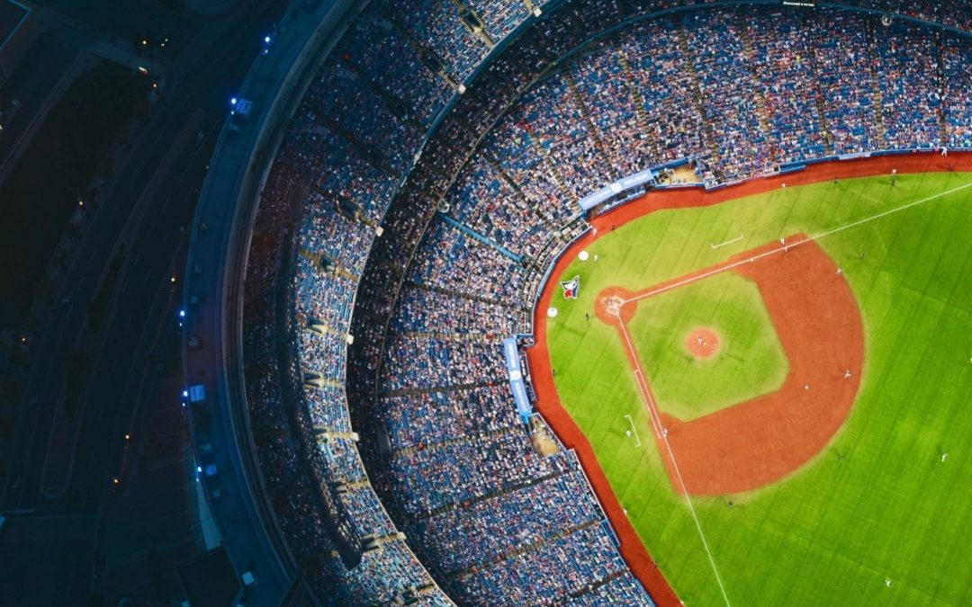 Aerial view of a baseball stadium which shows a Major League Baseball match Here are the five of the richest owners competing in the MLB