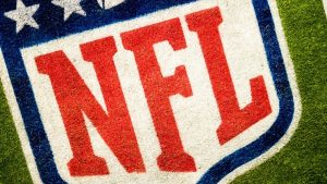 NFL logo has been painted on the grass.