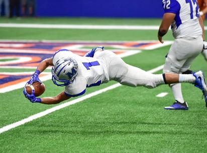 A football player scoring a touchdown